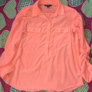 A pink top button down shirt